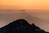 Sunrise with mists and lenticular clouds, Huangshan National Park, Anhui, China