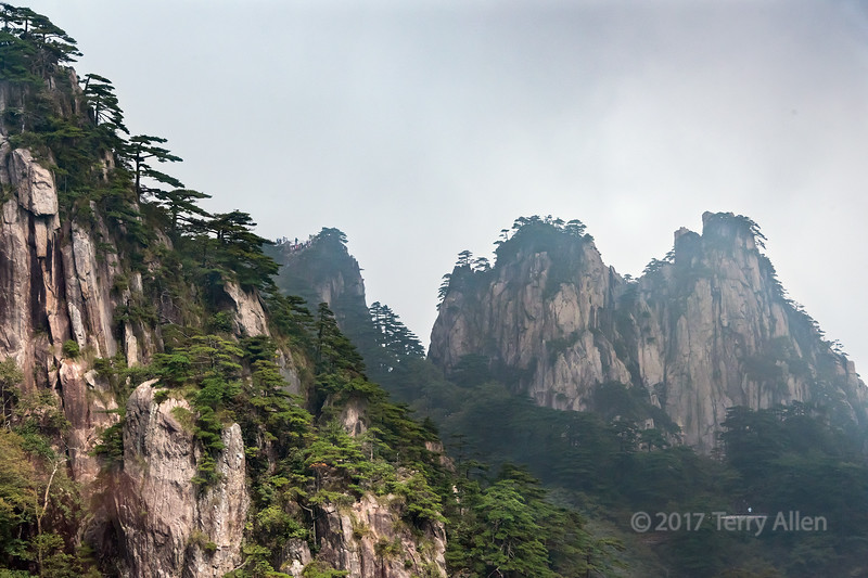 Distant walkway for viewing the rock formations of the Huangshan mountains, Anhui Province, China