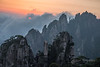 Sun rising through cloud bank, Huangshan, Anhui, China