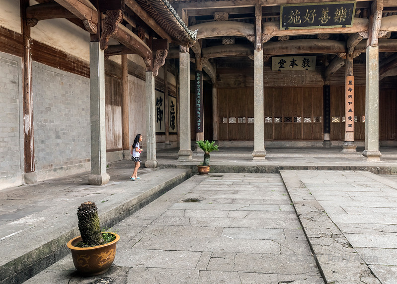 Young girl playing in Dun Ben Tang (Ancestral Hall for Men) Tangue, China