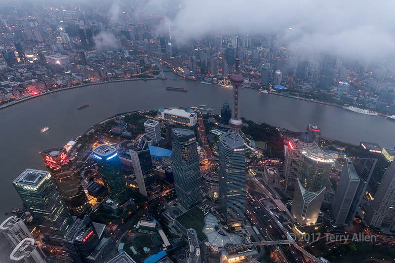 At the tail end of Typhoon Meranti I want up to the top of the Shanghai Tower (2nd tallest building in the world at 2,073 ft, 632 m) to photograph the night lights of Pudong from the observation deck on the 119th floor (1640 ft, 500 m), which only recently opened to the public. The clouds from the typhoon were still blowing past the top of the building and this shot was taken between gaps in the clouds and shows Pudong in the foreground, the Huangpu River and the Bund in the background.