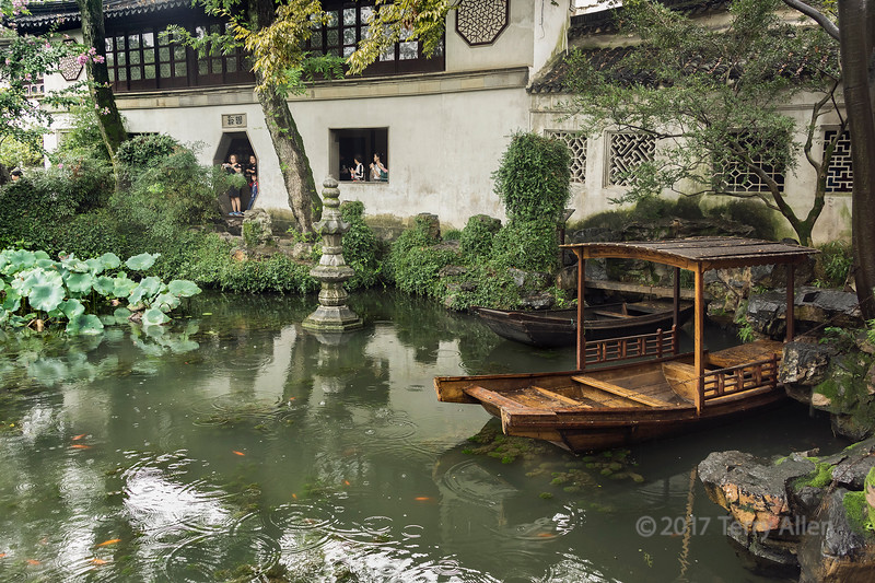 Liu Yuan (Lingering) Classical Garden in a light rain with wooden boats, UNESCO, Souzhou, China