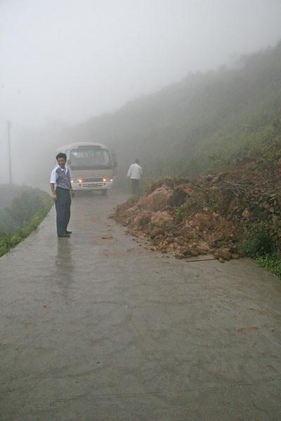 Our Van Driver Accessing a Recent Mudslide