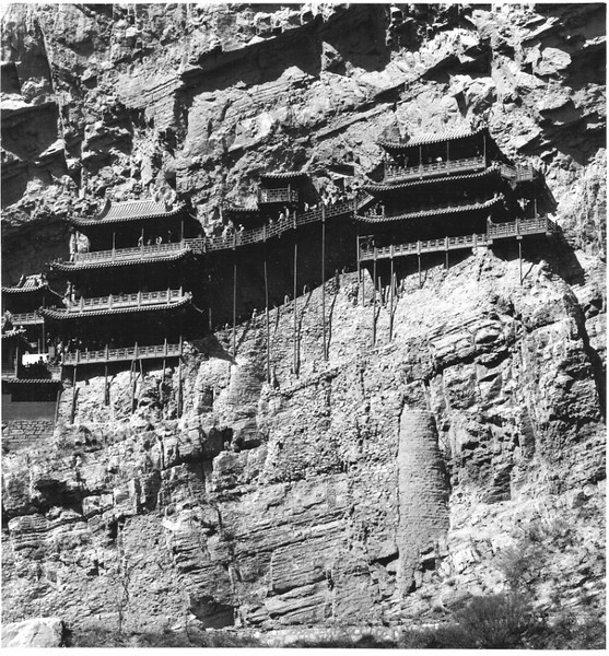 Monks built their monastery high on the cliff face to protect themselves and travelers from bandits. The rooms are only a few feet deep and just barely clinging the the cliff. This is near Datong.