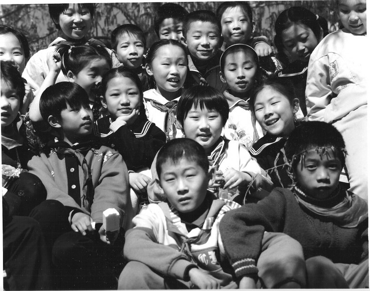 Walking along a small canal in Beijing a whole class swarmed around me. I asked their teacher if I could take a class photo. They all immediately crowded in, no one wanting to be left out.