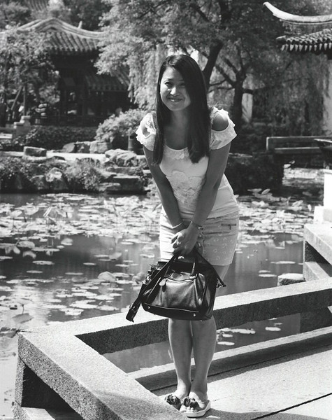 Suzhou, Zhou Zheng Garden. The swirl of family picture-taking placed her right in front of me; she graciously allowed me to take a turn also.