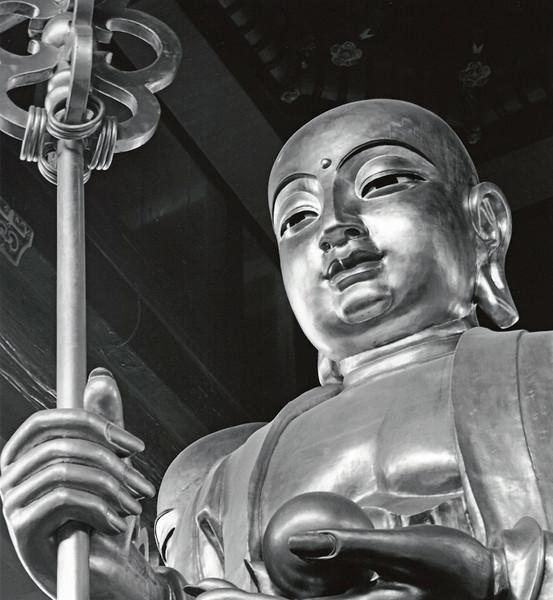 Jiuhuashan village, Buddha inside temple on a rainy day.