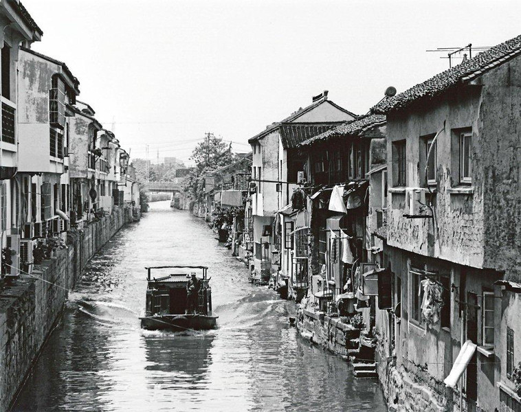 Suzhou, canal in Shangtangjie area. Outside the tourist district the canals are still basic transportation.