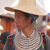 I'm not sure what ethnic group this woman belongs to (my guess is Bai).  She certainly has a spectacular silver necklace.