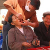 Village markets are also good places to get some teeth pulled--and for a lot less than your dentist at home would charge you.  I especially like the pliers on the table, the self-administered bottle of whatever, and the folks watching the action.