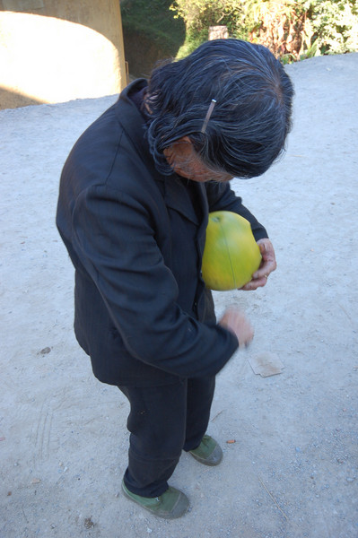 This old woman insisted on peeling a pomelo for us, which she proceeded to fling into sewage water