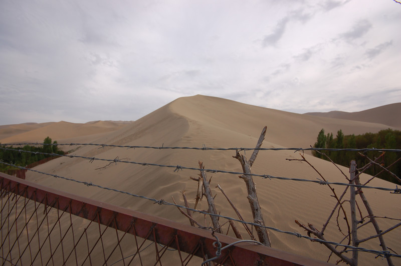 "Someone ""bought"" the sand dunes and fenced them off so that cheapies would not get sand action for free. Welcome to harmonious capitalism."