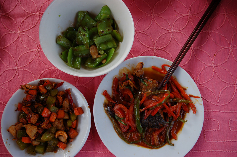 Chicken with cashew nuts, garlic snowpeas, beer fish, three dishes we learned how to make