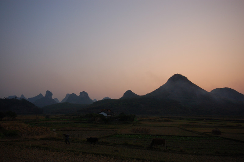 Sun sets and the villagers return home for dinner