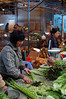 Peeling Chinese asparagus at the Yangshuo Market