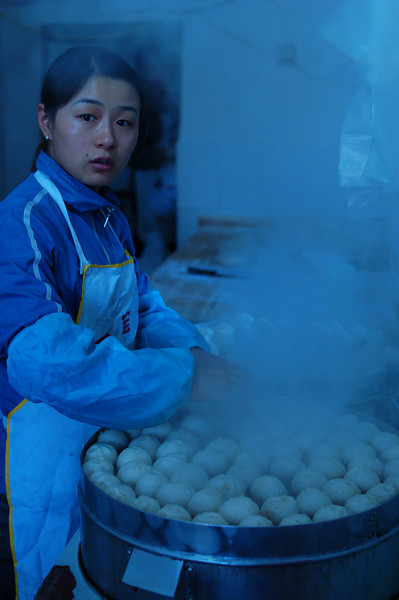 Steaming baozi for breakfast at the Yangshuo Market