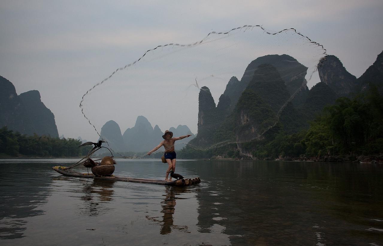 Fishing along Li River, Yangshuo, Guilin, China