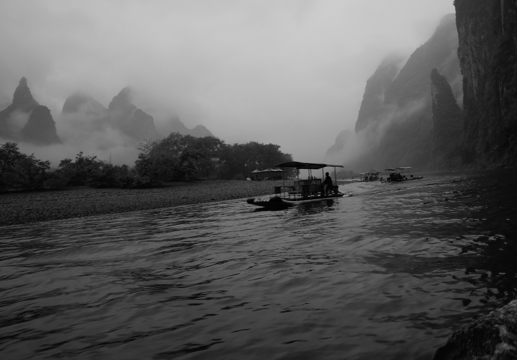 A river tour from Guilin to Yangshuo featuring gorgeous scenery, karst mountains and misty views - Guilin To Yangshuo, China.  This is a travel photo from Guilin to Yangshuo river cruise.  To purchase this photo click on it or to view the rest of my photos from this gallery click here.