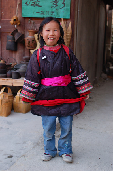Young Dong girl with fresh indigo coloured fabric