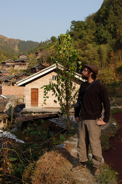 Yann stands on a terrace in a village near Zhaoxing