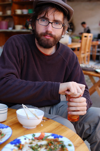 Yann prepares his daily coffee at the A Mei Restaurant