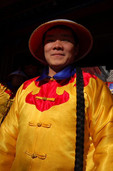 Puning Temple: A period costume clad greeter