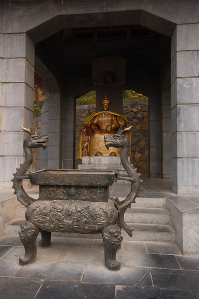 Golden statue of an emperor who visited the Longmen Caves