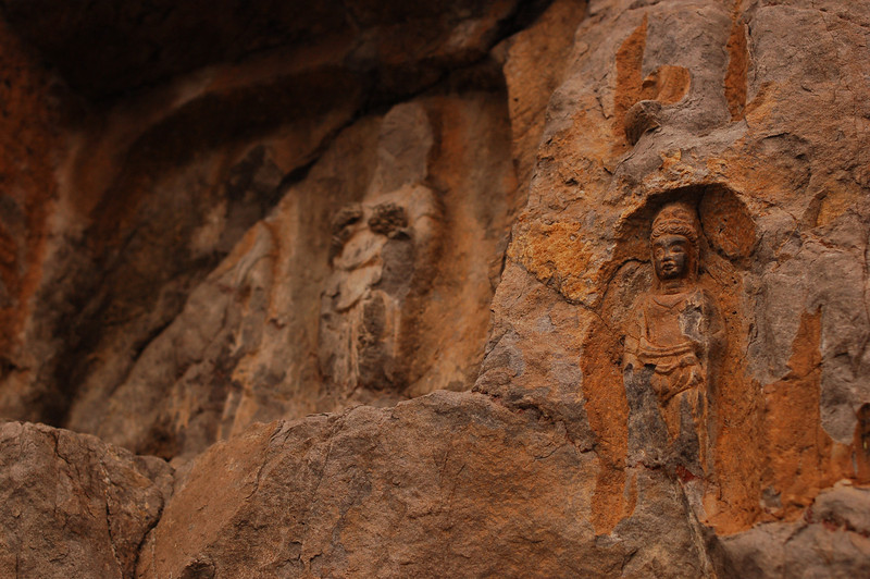 A small Buddhist carving outside a cave