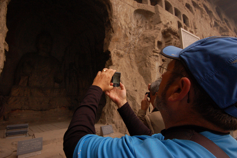 Jean photographing the Buddhas