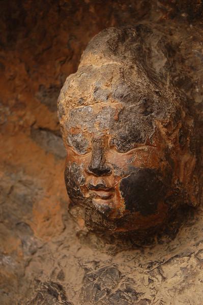 A Buddha of the Longmen Caves