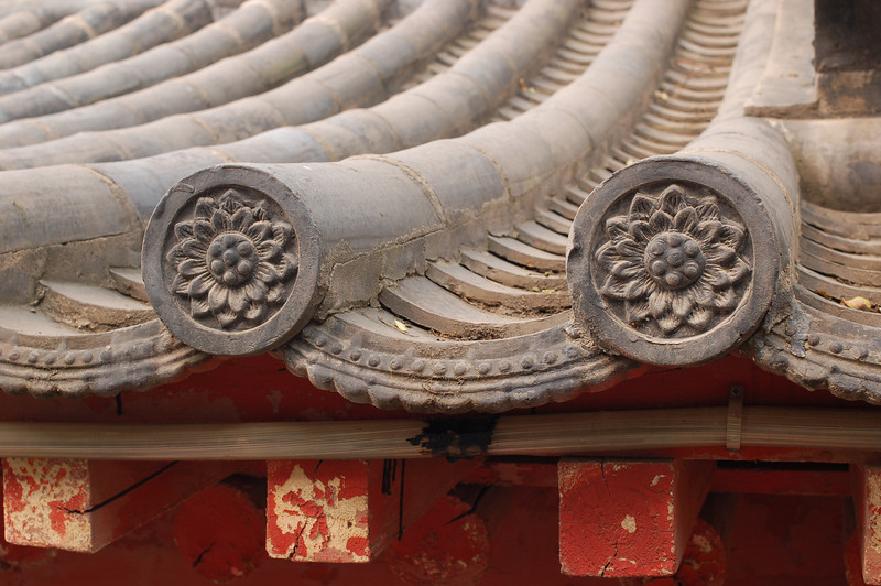 Lotus flowers on a temple roof