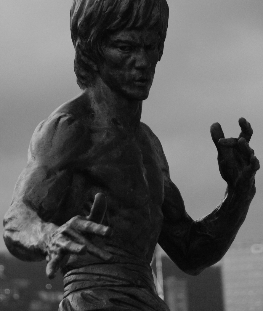 http://nomadicsamuel.com : Today's daily travel photo is of a Bruce Lee statue located along the Avenue of Stars overlooks the Victoria Harbour Waterfront - Hong Kong, China.