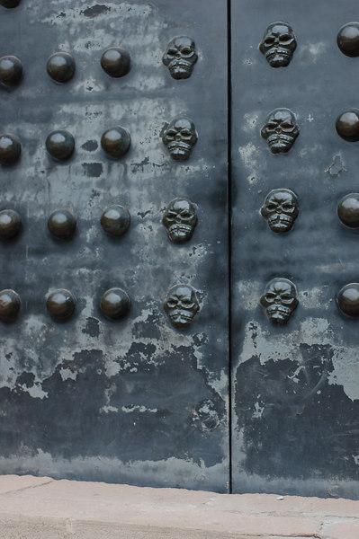 Skeletons on door of Ghost town temple