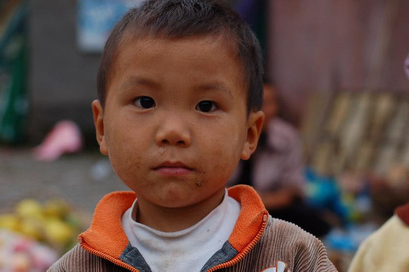 Child of fruit vendor
