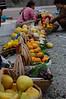 Fruit vendors outside Ghost town temple complex