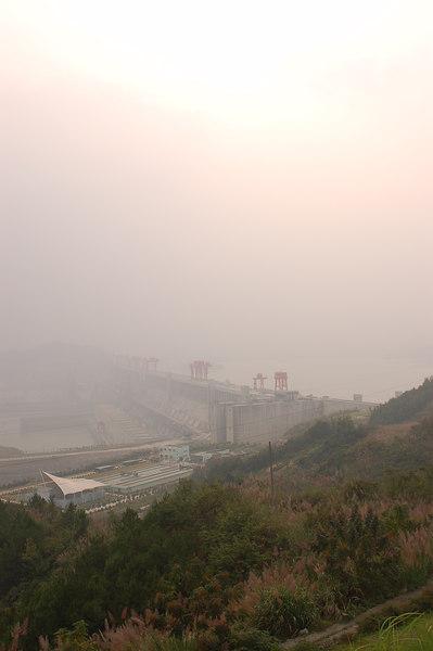 View of dam with hazy sky