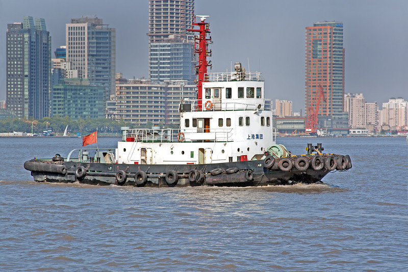 a barge in a busy Shanghai, China harbor