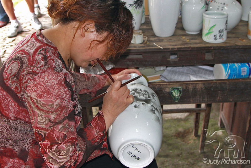 Intricate designs created on porcelain jug by Chinese artist