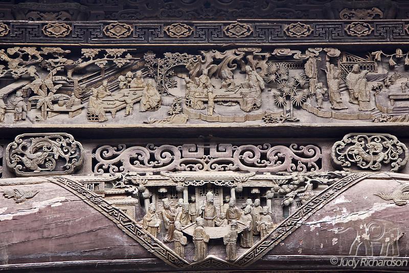 Ornate carvings on overhead beams in the Jingdezhen porcelain workshop