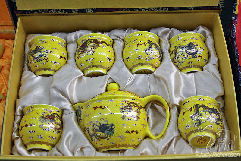 Boxed tea set with bright colors and intricate designs