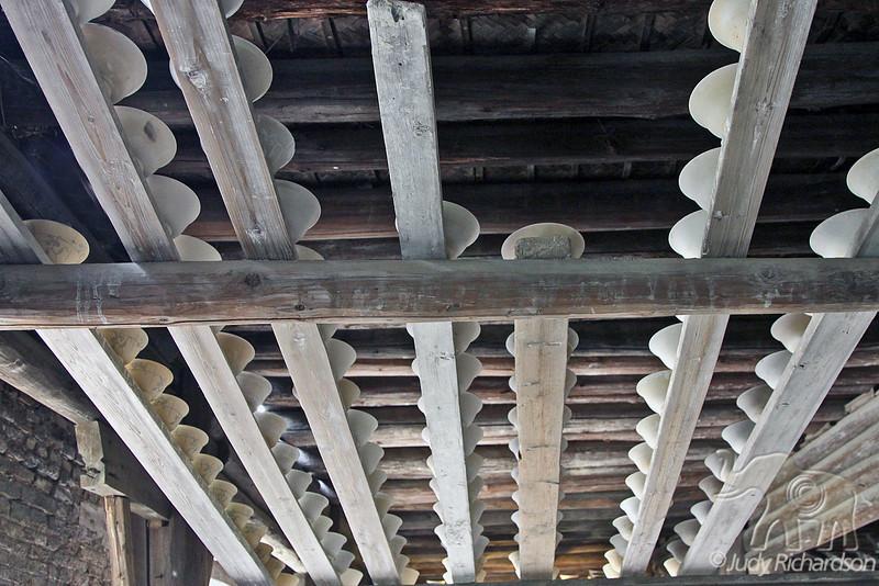 Overhead drying racks for porcelain bowls