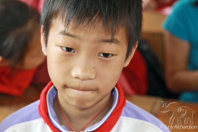 Chinese boy in classroom