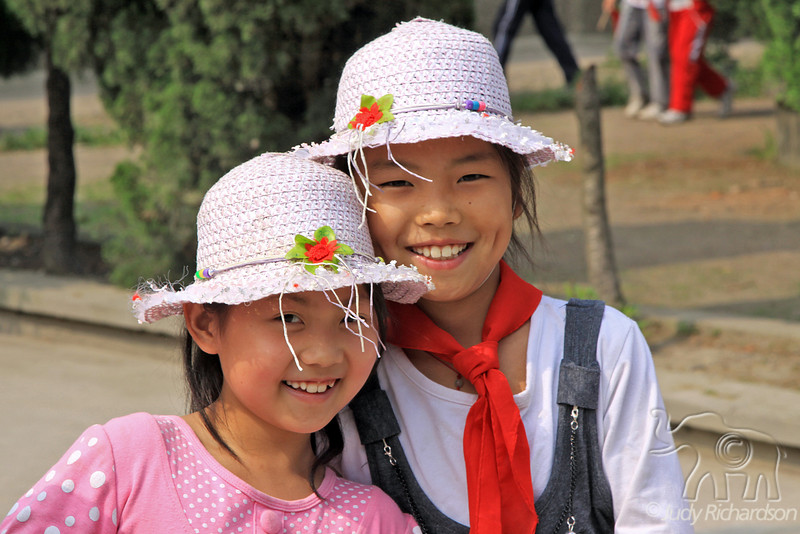 2 beautiful Chinese girls greet us with smiles as we arrive at Jingzhou Viking School