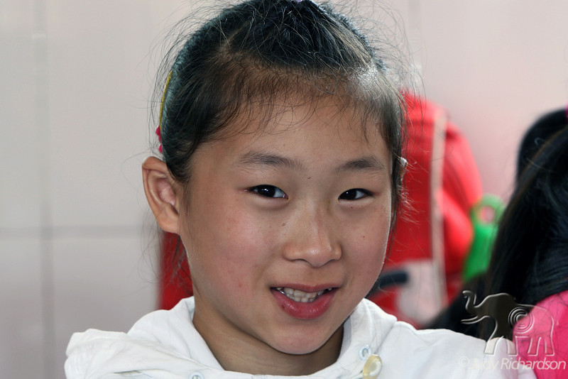 Chinese girl smiling for camera