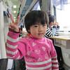 On the train from Shanghai to Kunming. I took out the camera and she immediately did Asian Camera Pose.