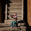 Corruption by the modern World! A child at a remote village in Shangrila took on a large bottle of Pepsi.