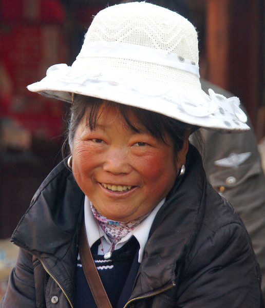 "Smiling local at the market in Lijiang, China.  This is a travel photo from Lijiang, China. <a href=""http://nomadicsamuel.com"">http://nomadicsamuel.com</a>"