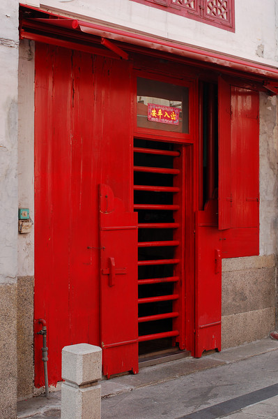 The red shutters of Rue de la Felicidade (Street of Happiness), the former red light district