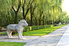 Carved statues of animals along the General Sacred Way at the Ming Tombs Museum in Beijing, China.