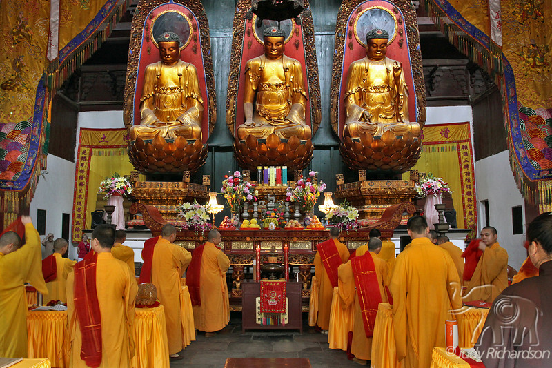 Buddhist Monks preparing for worship service in temple